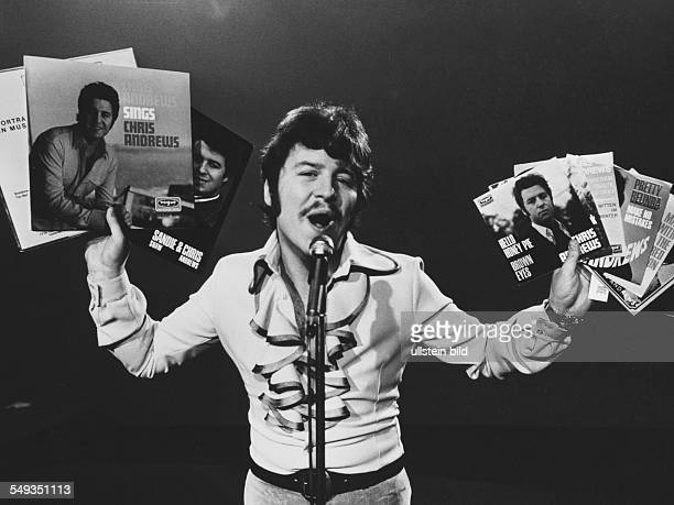 English popsinger Chris Andrews singing with records in his hands