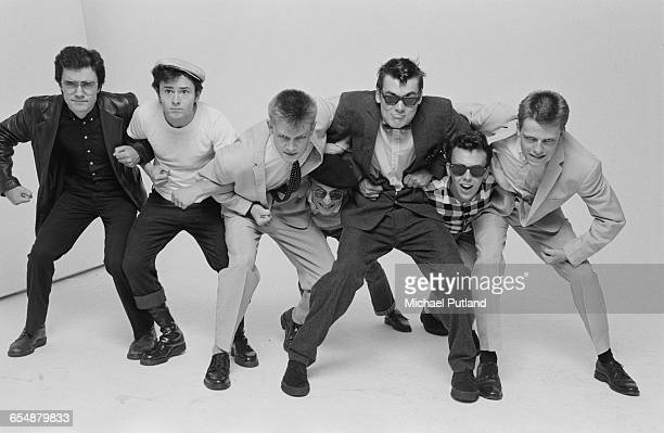 English pop/ska band Madness during the cover shoot for their album '7' London 1981 Left to right Chris Foreman Lee Thompson Chas Smash Daniel...