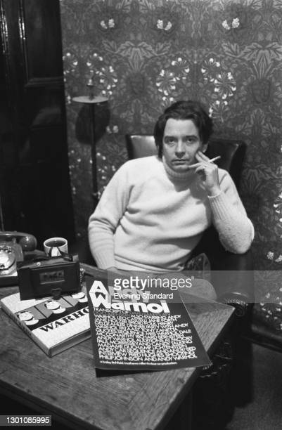 English portrait photographer David Bailey with the transcript of his ATV documentary on pop artist Andy Warhol, UK, February 1973. The work was...