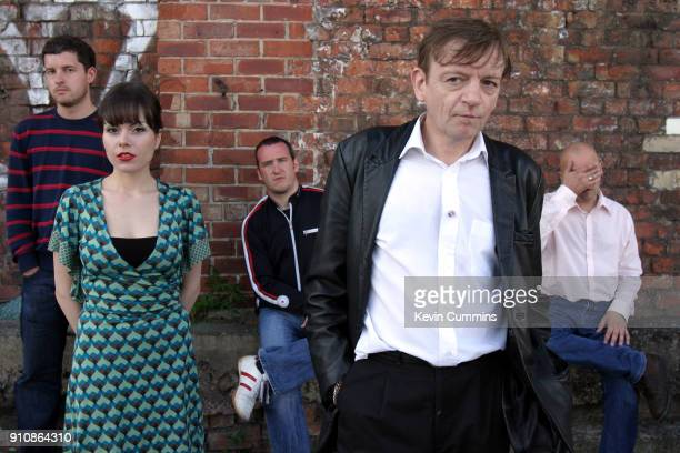 English postpunk band The Fall Salford 15th August 2006 Left to right guitarist Ben Pritchard keyboard player Elena Poulou bassist Steve Trafford...