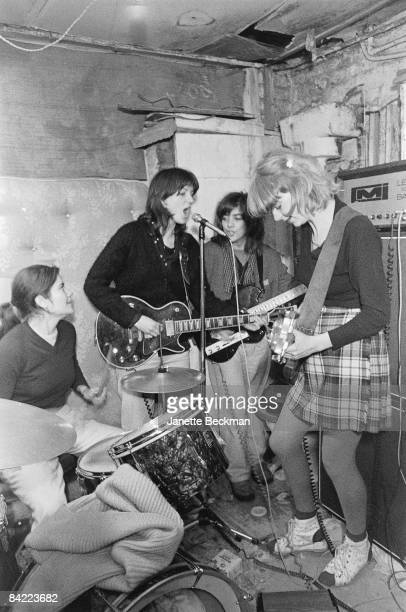 English postpunk women's band The Raincoats from left Palmolive on drums Vicky Aspinall Ana da Silva and Gina Birch rehearse in their West London...