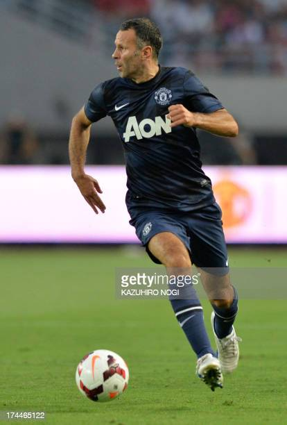 English Premier League Manchester United player, Ryan Giggs, controls the ball during the friendly football match against Japan's Cerezo Osaka at...