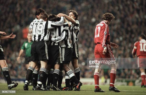 English Premier League match at Anfield Liverpool 4 v Newcastle United 3 Newcastle players celebrate a goal as Steve McManaman walks away dejectedly...