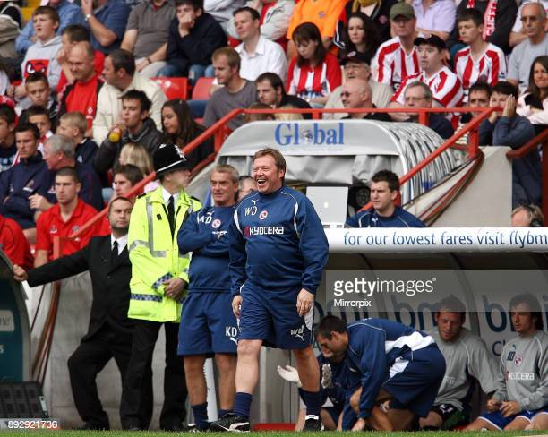 English Premier League match at Bramall Lane Sheffield United 1 v Reading 2 Reading management staff Wally Downes and Kevin Dillon celebrate after...