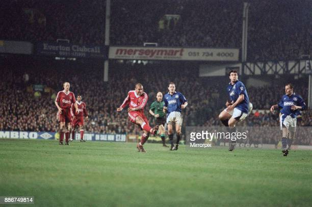 English Premier League match at Goodison Park Everton 1 v Liverpool 1 David Unsworth feels the full force of a shot by Liverpool forward Stan...