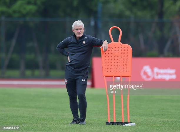English Premier League side Southampton's Welsh manager Mark Hughes looks on during a training session before their friendly football match against...