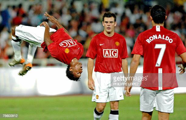 English Premiership champions Manchester United's Nani Almeida performs a somersault after scoring against Chinese football club Shenzhen in Macau 23...