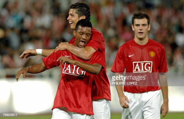 English Premiership champions Manchester United's Nani Almeida celebrates with his teammate Cristiano Ronaldo after scoring against Chinese football...