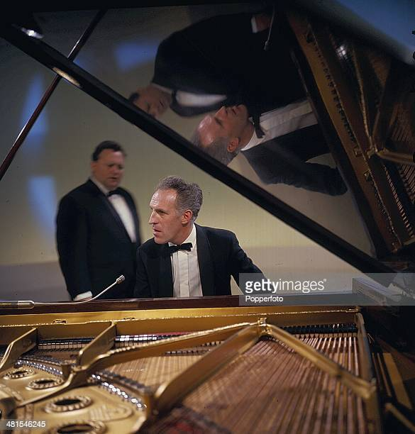 1968 English presenter and entertainer Bruce Forsyth performs at the piano on the television show 'Secombe and Friends' in 1968 Harry Secombe can be...