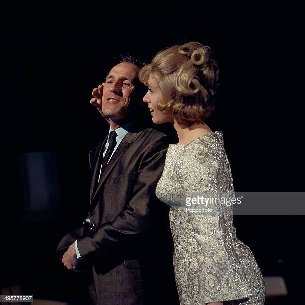 English presenter and entertainer Bruce Forsyth pictured with actress Aleta Morrison on 'The Bruce Forsyth Show' in 1967
