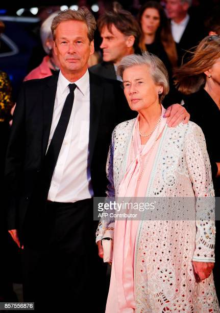 English producer Jonathan Cavendish and his mother Diana Blacker pose upon arrival for the European premiere of the film Breathe during the opening...