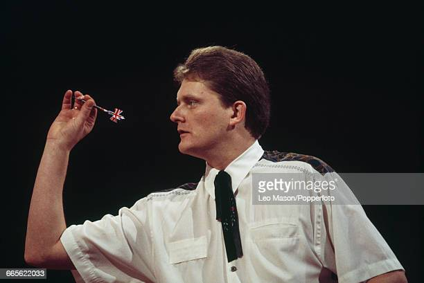 English professional darts player Alan Warriner pictured in action competing in the 1993 BDO Embassy World Darts Championship tournament at the...