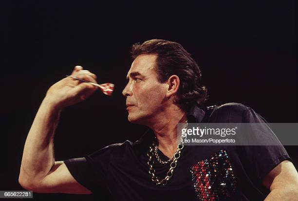 English professional darts player Bobby George pictured in action competing to progress to the semi finals of the 1993 BDO Embassy World Darts...