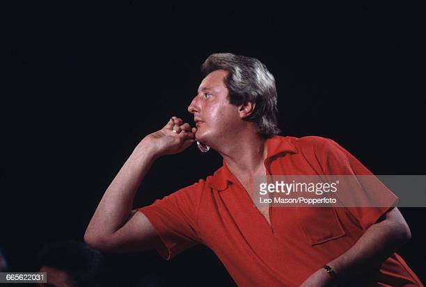 English professional darts player Eric Bristow pictured in action competing in a championship darts tournament in the United Kingdom circa 1990