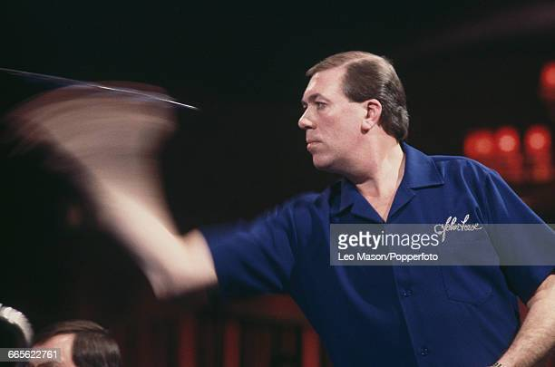 English professional darts player John Lowe pictured in action competing to progress to win the final of the 1987 BDO Embassy World Darts...