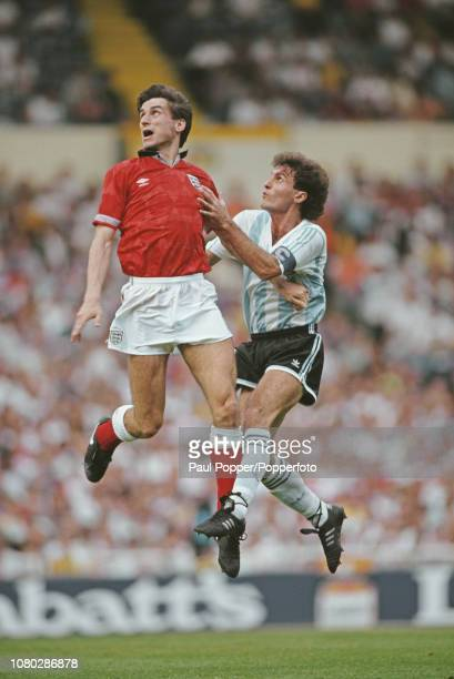 English professional footballer Alan Smith forward with Arsenal pictured jumping for the ball with Oscar Ruggeri of Argentina during play between...