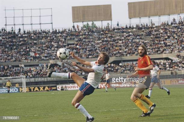 English professional footballer and defender with Liverpool, Phil Neal pictured with the ball as Luc Millecamps of Belgium looks on during the UEFA...