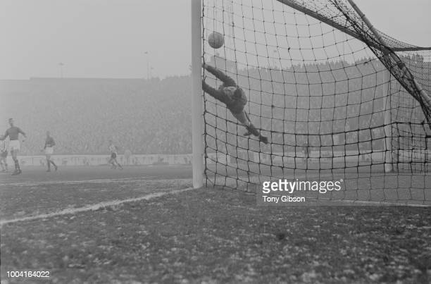 English professional footballer and goalkeeper with Chelsea Peter Bonetti dives to attempt a save during the League Division One match between...