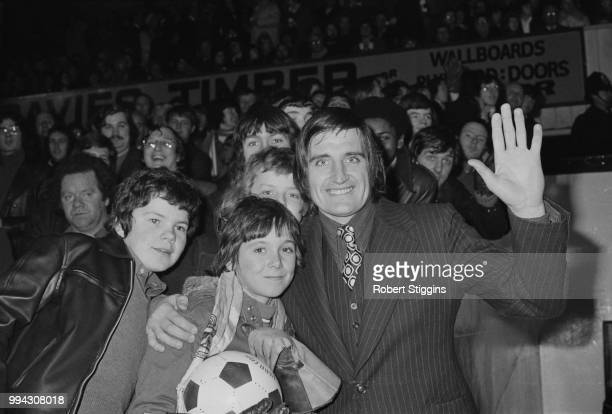 English professional footballer and goalkeeper with Crystal Palace FC John Jackson pictured with fans at the club's Selhurst Park ground for his...