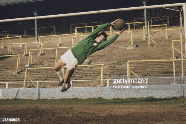 English professional footballer and goalkeeper with Millwall Football Club Bryan King pictured saving a ball during a training session on the pitch...