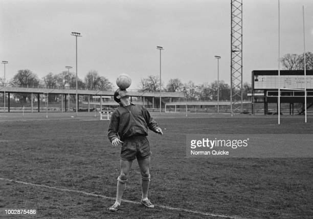 English professional footballer and midfielder with Crystal Palace FC, David Burnside pictured balancing a ball on his forehead during a training...