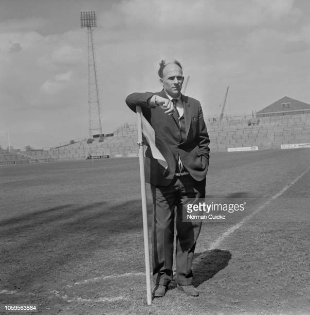 English professional footballer and midfielder with Fulham FC Eddie Lowe pictured by a corner flag at the club's Craven Cottage ground in West London...