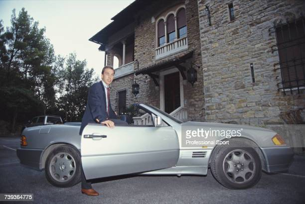 English professional footballer and midfielder with Italian club Sampdoria, David Platt pictured getting in to his Mercedes-Benz 500SL car outside...