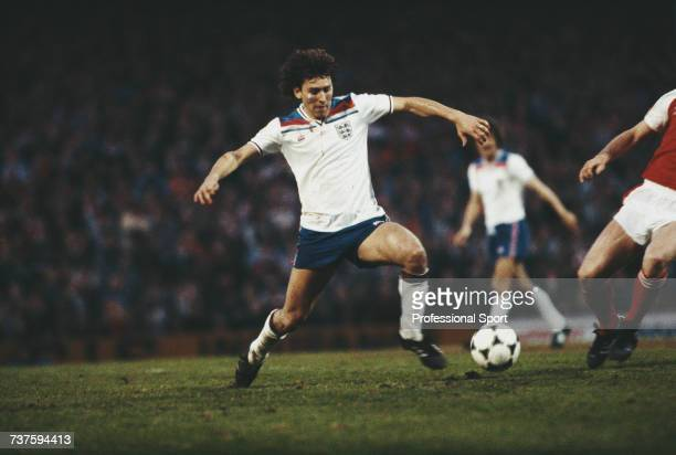 English professional footballer and midfielder with Manchester United Bryan Robson pictured in action for the England national football team during...