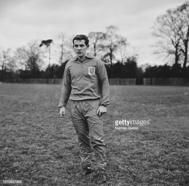 English professional footballer and midfielder with Tottenham Hotspur FC Alan Mullery pictured during a training session with the England national...