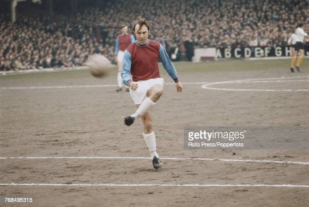 English professional footballer and striker with West Ham United Football Club Jimmy Greaves pictured on the pitch prior to a match in 1970