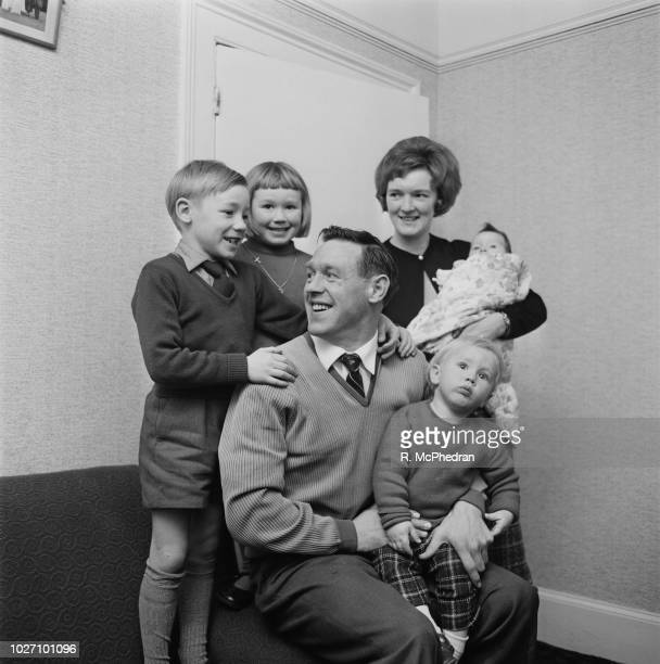 English professional footballer Billy Gray new manager of Millwall FC pictured together with his wife and four children at home on 30th November 1963