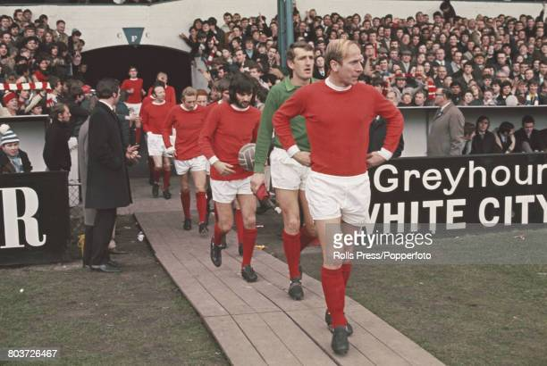 English professional footballer Bobby Charlton leads out team mates including goalkeeper Alex Stepney and George Best behind on to the pitch at...