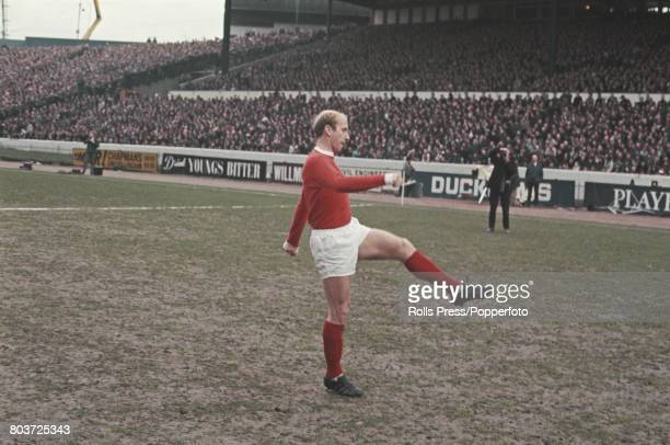English professional footballer Bobby Charlton of Manchester United warms up prior to kick off in the League Division One match between Chelsea and...
