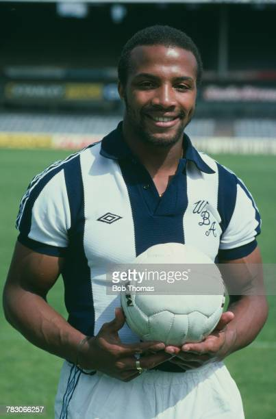 English professional footballer Cyrille Regis of West Bromwich Albion pictured holding a football circa 1980