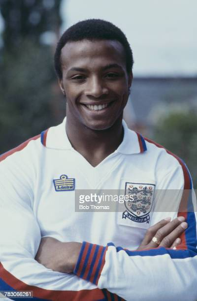 English professional footballer Cyrille Regis of West Bromwich Albion posed wearing an England national football team under21 shirt circa 1979