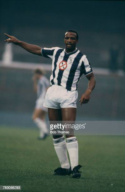 English professional footballer Cyrille Regis pictured in action for West Bromwich Albion in their League Division One match against Everton at The...
