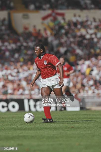 English professional footballer David Rocastle midfielder with Arsenal pictured with the ball during play between England and Brazil in an...