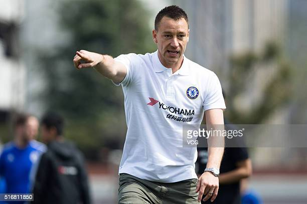 English professional footballer John George Terry arrives at Nanyang High School for a guidance as he starts a visit in China on March 21 2016 in...
