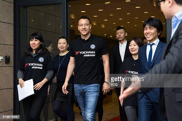 English professional footballer John George Terry arrives at Pudong International Airport as he starts a visit in China on March 20 2016 in Shanghai...