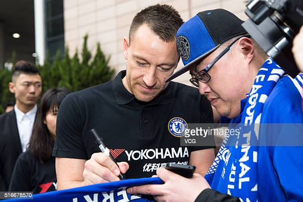 English professional footballer John George Terry gives an signature to a fan as he starts a visit in China on March 20 2016 in Shanghai China