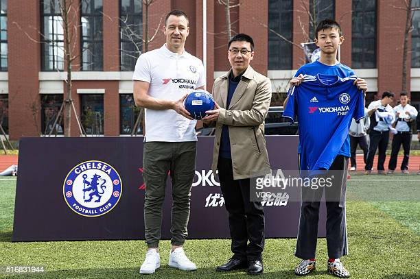 English professional footballer John George Terry poses at Nanyang High School as he starts a visit in China on March 21 2016 in Shanghai China