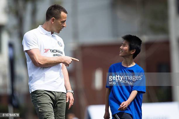 English professional footballer John Terry arrives at Nanyang High School for a guidance as he starts a visit in China on March 21 2016 in Shanghai...