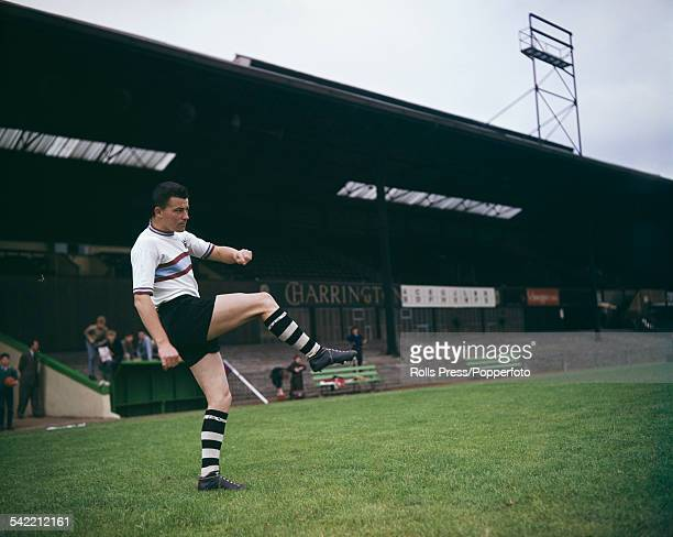 English professional footballer Johnny Byrne pictured wearing Crystal Palace FC kit during a training session in London circa 1962