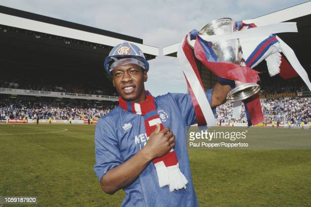 English professional footballer Mark Walters midfielder with Rangers FC celebrates with the trophy on the pitch after Rangers beat Aberdeen 20 at...