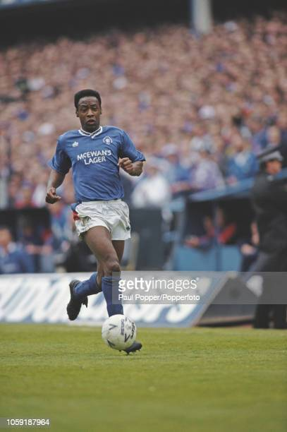 English professional footballer Mark Walters, midfielder with Rangers FC, pictured in action for Rangers in a match against Aberdeen during...