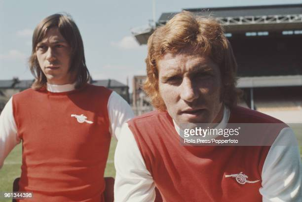 English professional footballers with Arsenal Football Club, midfielder Alan Ball in front and forward Charlie George behind, posed together on the...