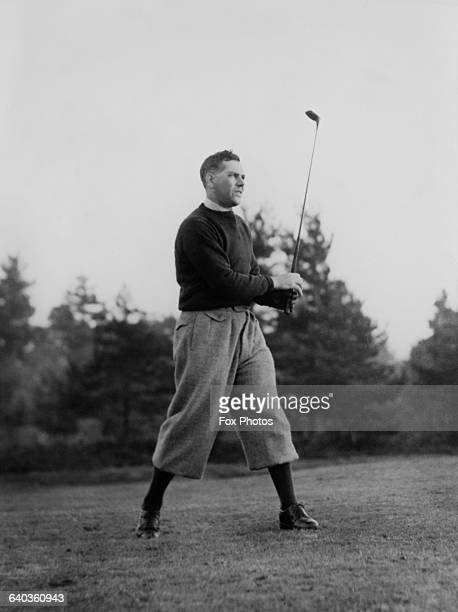 English professional golfer Arthur Lacey of Berkshire approaches the 13th during the Guildford Alliance Foursomes Tournament at Camberley Heath UK...