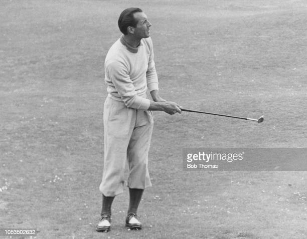English professional golfer Max Faulkner plays a shot to the 16th green during competition to win the 1951 Open Championship at Royal Portrush Golf...