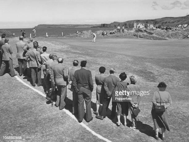 English professional golfer Max Faulkner plays a shot to the 5th hole during competition to win the 1951 Open Championship at Royal Portrush Golf...