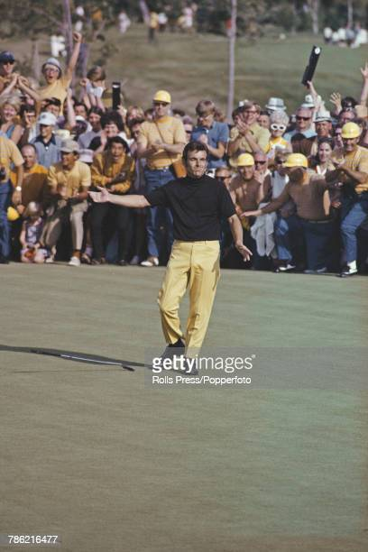 English professional golfer Tony Jacklin drops his putter on a green in celebration during competition to win the 1970 US Open Championship golf...